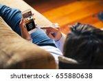 woman watching tv series in a... | Shutterstock . vector #655880638