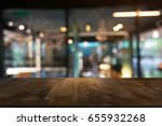 empty wooden table in front of... | Shutterstock . vector #655932268
