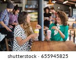 happy female friends looking at ... | Shutterstock . vector #655945825