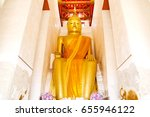 big golden buddha statue in wat ... | Shutterstock . vector #655946122