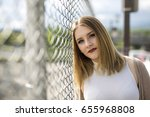 a pretty young woman standing...   Shutterstock . vector #655968808