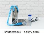 stethoscope on modern laptop...   Shutterstock . vector #655975288