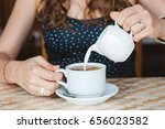young caucasian woman pouring... | Shutterstock . vector #656023582