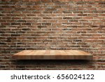 empty wooden shelf on old brick ... | Shutterstock . vector #656024122
