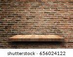 empty wooden shelf on old brick ...   Shutterstock . vector #656024122
