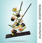 flying sushi pieces served on... | Shutterstock . vector #656054056