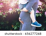 pregnant woman with child.... | Shutterstock . vector #656277268