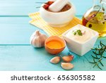 Small photo of Garlic sauce Aioli on the blue wooden background. Copy space. Selective focus.