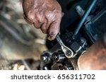 hands repairing a engine with a ... | Shutterstock . vector #656311702