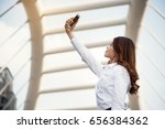 business woman take photo by... | Shutterstock . vector #656384362