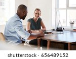 man and woman sitting at a desk ... | Shutterstock . vector #656489152