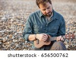 young man playing ukulele in...   Shutterstock . vector #656500762