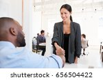 woman greeting a black... | Shutterstock . vector #656504422