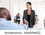 woman greeting a black... | Shutterstock . vector #656504422