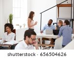 colleagues in discussion around ... | Shutterstock . vector #656504626