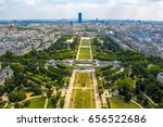 Small photo of Champ de Mars view from top of eiffel tower looking down see the entire city as a beautiful classic architecture. A romantic place for lovers and family to visit.