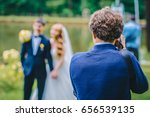 a wedding photographer takes... | Shutterstock . vector #656539135