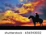 Silhouette Of Cowboy On Horse...