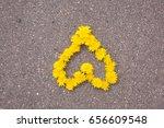 a heart of dandelion flowers on ... | Shutterstock . vector #656609548