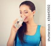 young beautiful woman drinking... | Shutterstock . vector #656643502