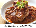 Classic osso buco.  Veal shanks slow cooked with tomatoes, carrots and onion.  Hearty, warming food. - stock photo