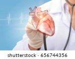 cardiologist listens to the... | Shutterstock . vector #656744356
