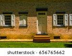 a doorway of a brick house in... | Shutterstock . vector #656765662