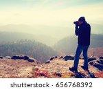 photographer  on cliff. nature... | Shutterstock . vector #656768392