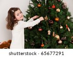 Little Girl Decorating The...
