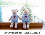 two teddy bear sitting on a... | Shutterstock . vector #656822815