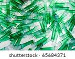 Green plastic tubes - stock photo