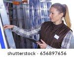 female worker looking up in... | Shutterstock . vector #656897656