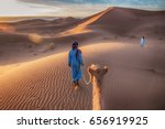 two tuareg nomads leading a... | Shutterstock . vector #656919925