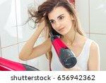 young cute brunette dries hair   Shutterstock . vector #656942362