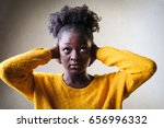 black woman covering her ears... | Shutterstock . vector #656996332