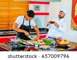 colleagues at work  thai and... | Shutterstock . vector #657009796