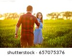 romantic couple running in... | Shutterstock . vector #657075376