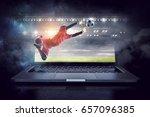 soccer goalkeeper in action.... | Shutterstock . vector #657096385