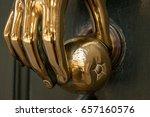 golden handle with hand shape... | Shutterstock . vector #657160576