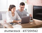 smiling young couple using... | Shutterstock . vector #657204562