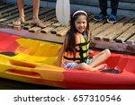smiling little girl kayaking on ... | Shutterstock . vector #657310546