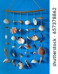 A Wind Chime With Shells On A...