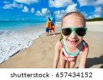 little girl and her family... | Shutterstock . vector #657434152