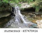 the shifen waterfall in pingxi  ... | Shutterstock . vector #657470416