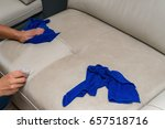 cleaning leather sofa at home... | Shutterstock . vector #657518716