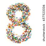 Small photo of Confetti alphabet: number - figure with isolated background