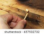 a man holding a lit match. this ... | Shutterstock . vector #657532732