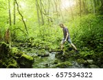 young red haired man crossing a ... | Shutterstock . vector #657534322
