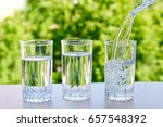 three glasses of water on a... | Shutterstock . vector #657548392