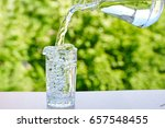 water is poured from a jug... | Shutterstock . vector #657548455
